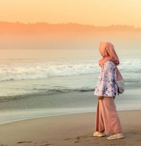 woman in orange hijab standing on beach during sunset 3861471 compressor